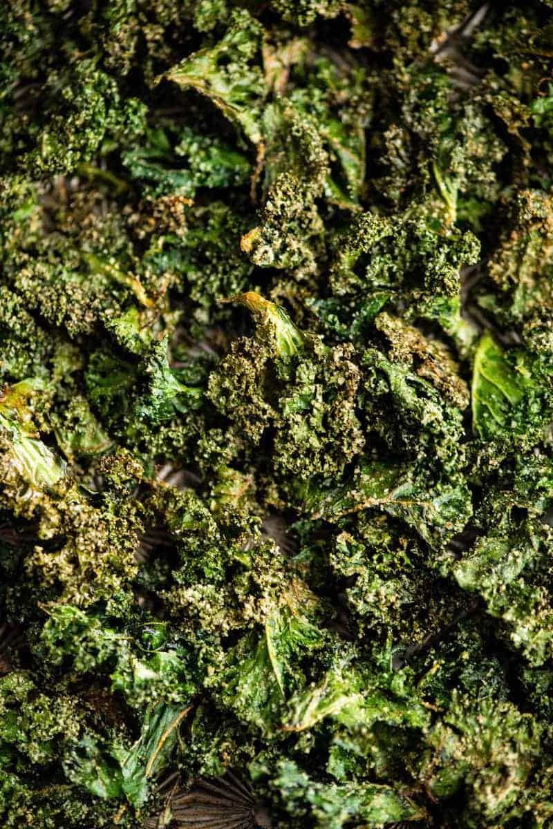 up close overhead view of baked kale chips after baking