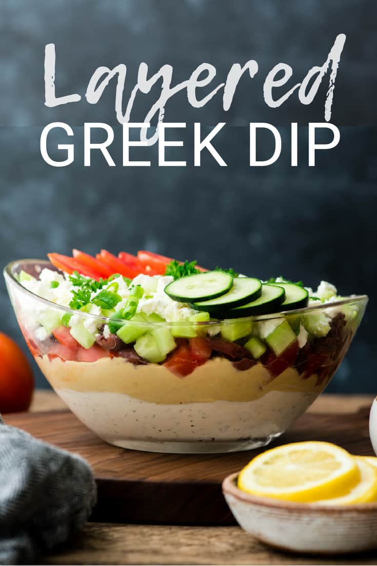 This Layered Greek Dip Recipe is the perfect healthier appetizer to serve when you're entertaining this summer! It's always the hit of the party (or BBQ)!  It's gluten-free and only takes 10 minutes of prep time!  #recipe #appetizer #healthy #glutenfree #bbq #dip #Greekdip #layereddip