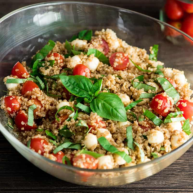 Front view of a glass serving dish filled with Balsamic Caprese Quinoa Salad