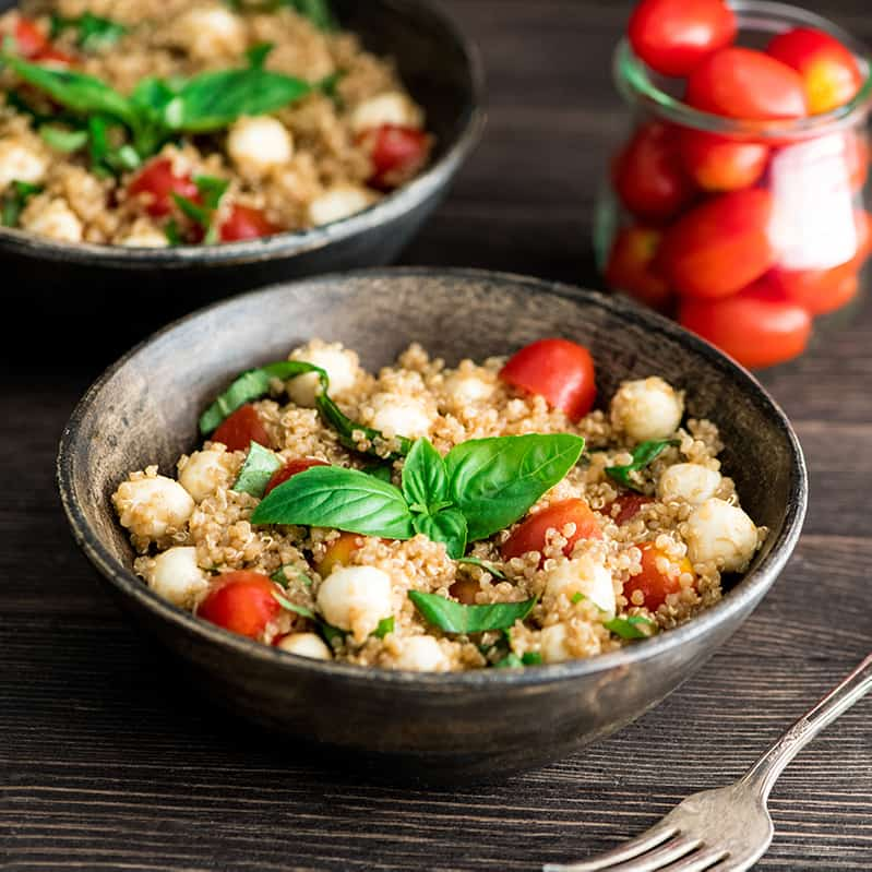 Front view of two bowls of Balsamic Caprese Quinoa Salad
