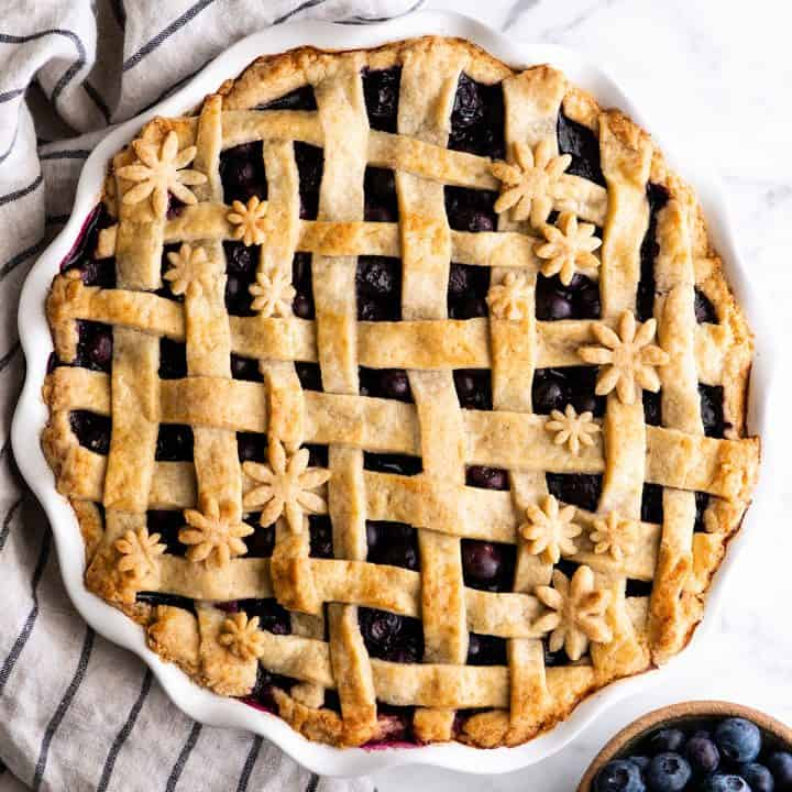 overhead view of a baked blueberry pie with a lattice crust