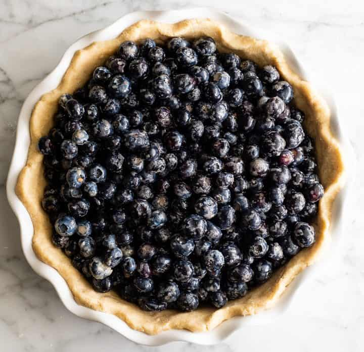 overhead photo showing how to make blueberry pie