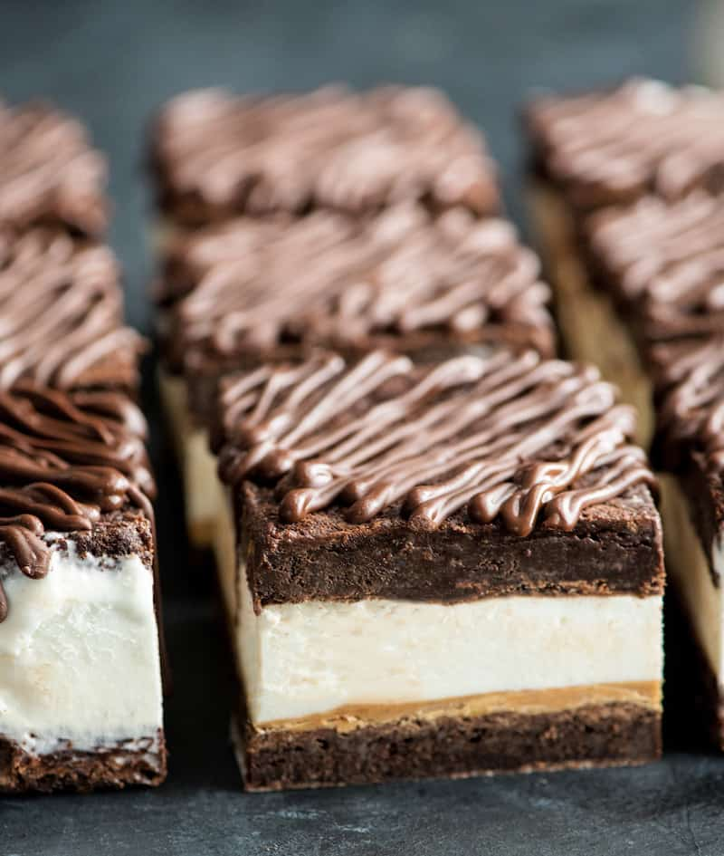 front view of nine Peanut Butter Brownie Ice Cream Sandwiches lined up the three rows of three