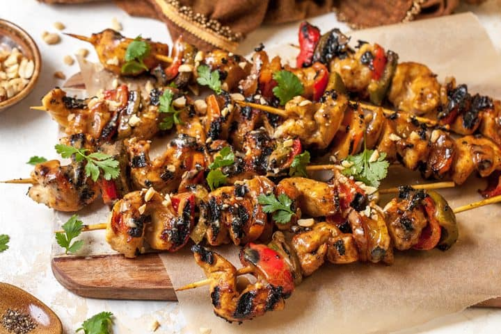 chicken satay skewers on a plate