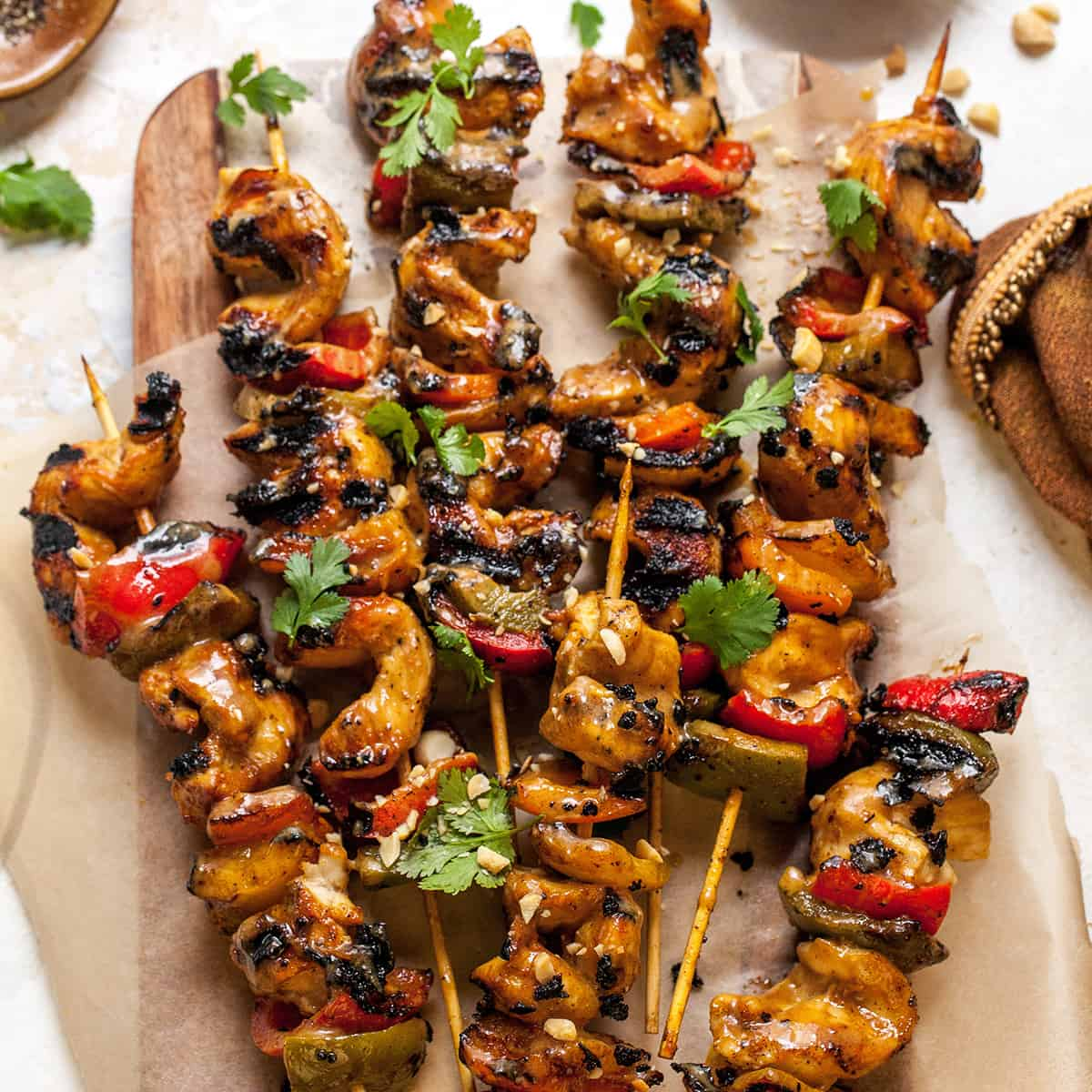 overhead view of chicken satay skewers on a serving plate