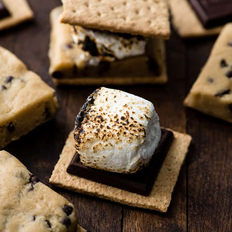 front view of a toasted marshmallow on top of a graham cracker being ready to be made into this Cookie Dough s'mores recipe