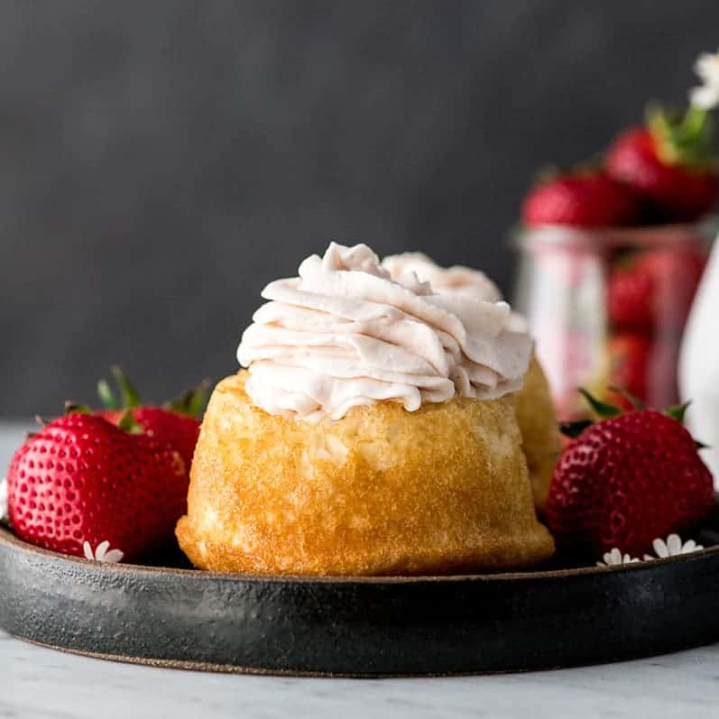 Front view of Strawberry Whipped Cream piled high on a sponge cake