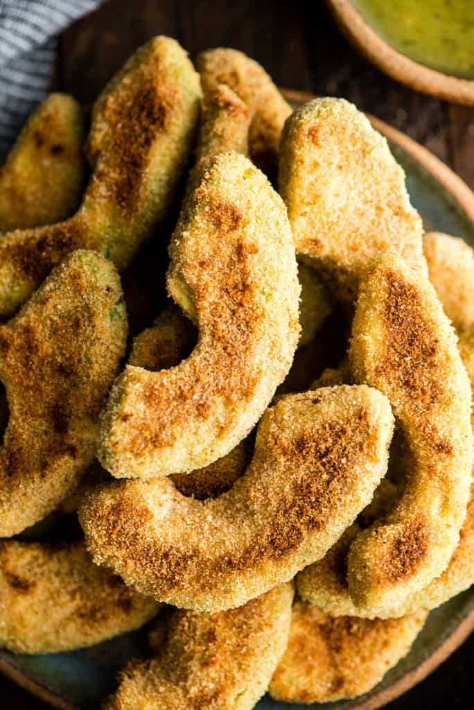 up close overhead view of Baked Avocado Fries recipe after they have been removed from the oven and arranged on a plate
