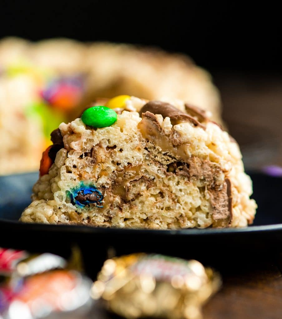 Front view of a piece of Candy-Stuffed Rice Crispy Cake on a plate