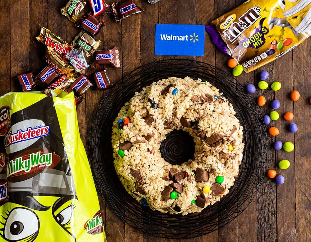 Overhead view of Candy-Stuffed Rice Crispy Cake on a serving plate surrounded by Mars candies