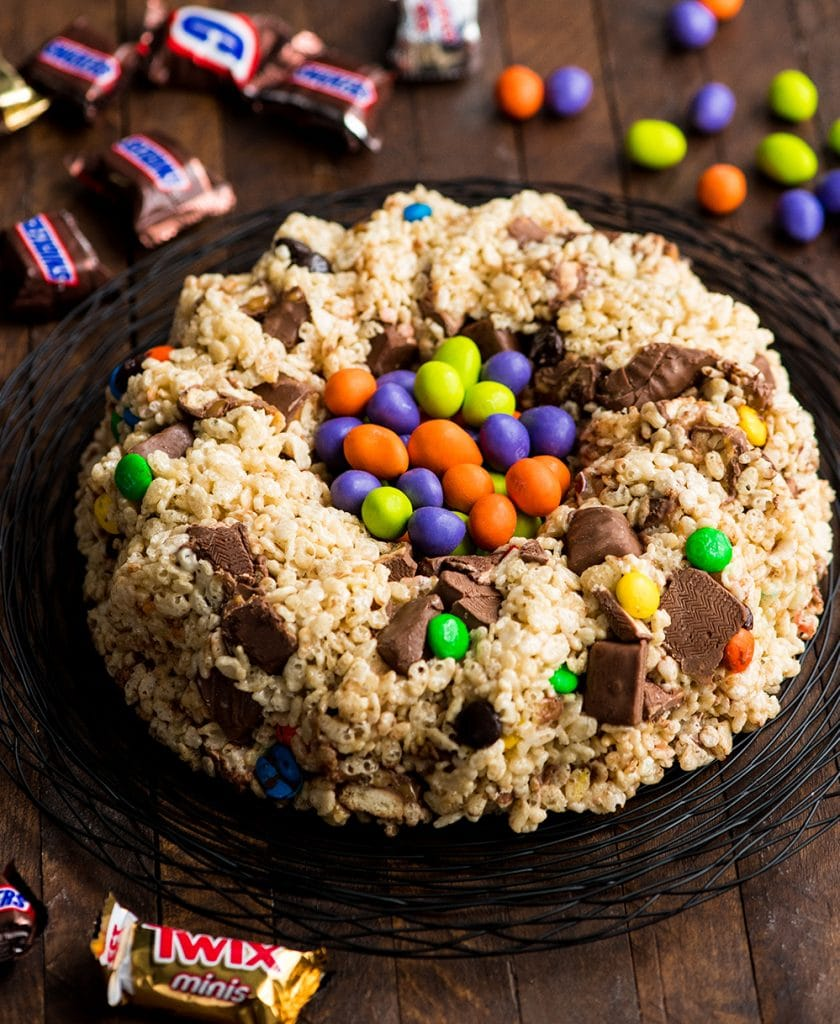 front/overhead view of Candy-Stuffed Rice Crispy Cake recipe on a serving plate filled with M&Ms
