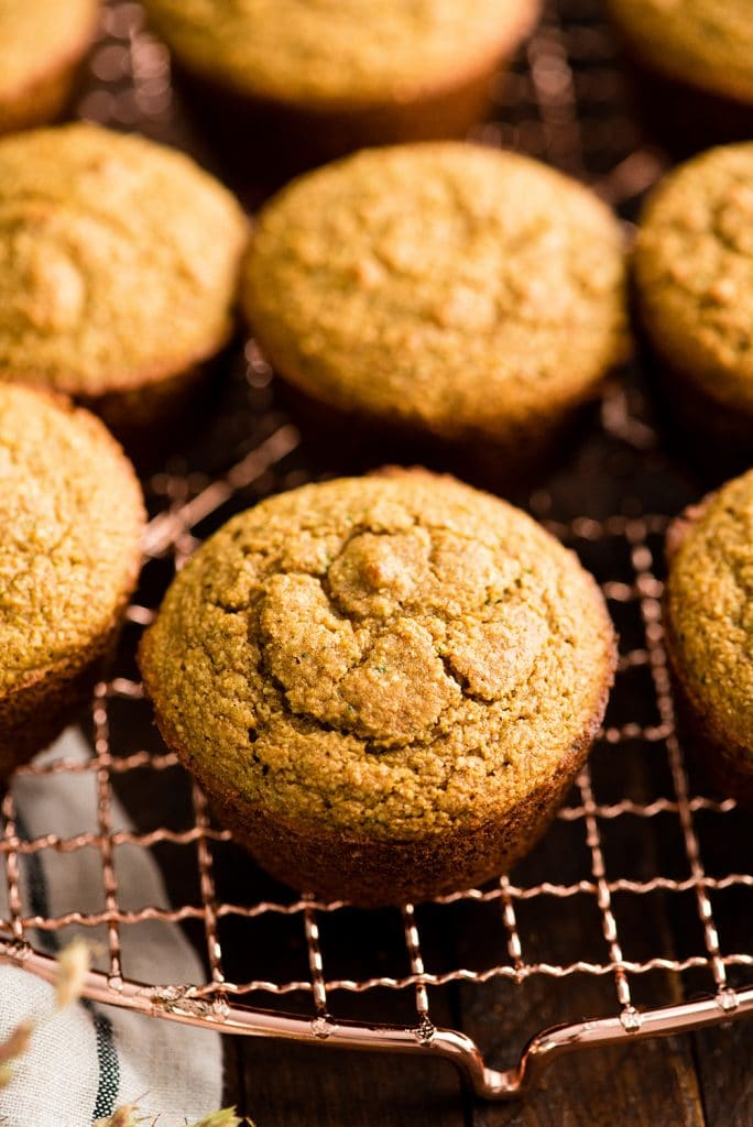 up close front view of Carrot Zucchini Muffins on a cooling rack