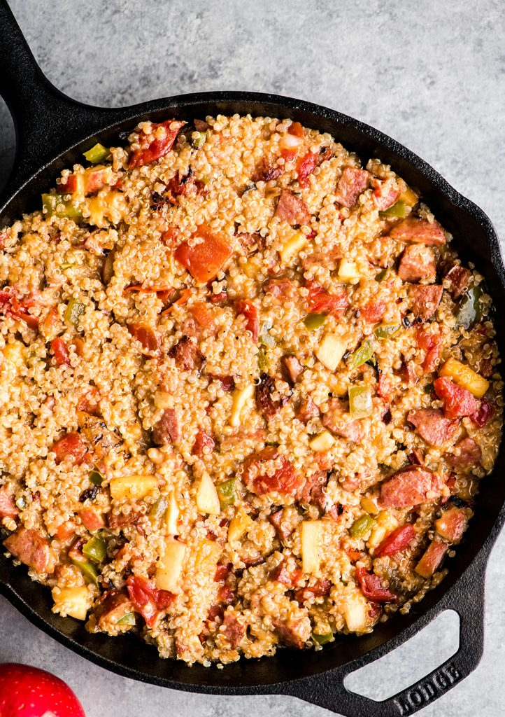 overhead view of the final quinoa mixture in a cast iron skillet before adding cheese on top in the making of this Baked Quinoa Casserole recipe