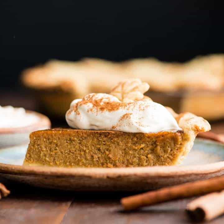 This Homemade Dairy-Free Pumpkin Pie recipe is seriously delicious!  This coconut milk pumpkin pie is creamy, perfectly sweet and loaded with cozy fall spices - a must-make Thanksgiving dessert.