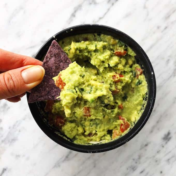 overhead view of easy homemade guacamole in a bowl