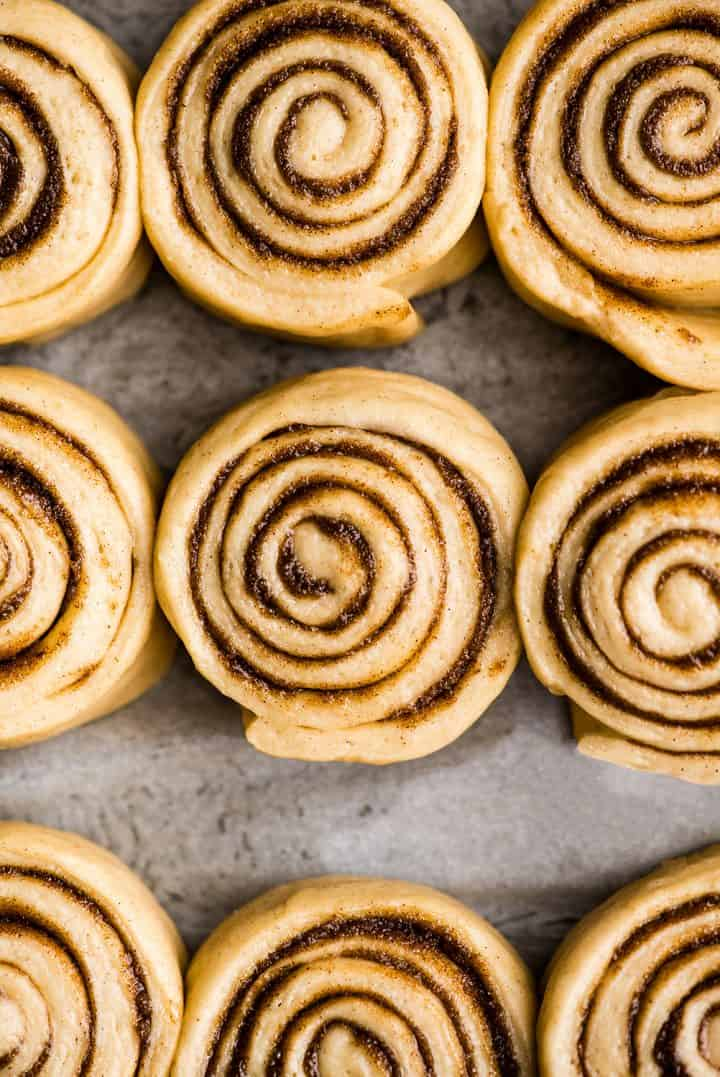 overhead photo showing how to make cinnamon rolls - rolls risen