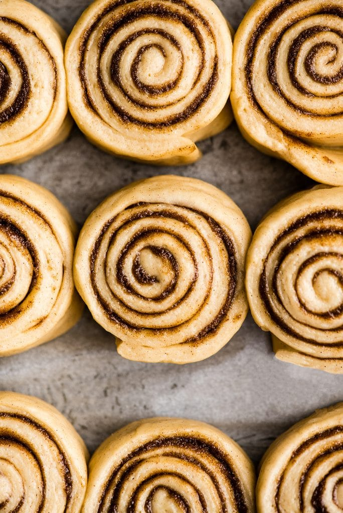 Overhead view of the best cinnamon rolls recipe in a baking pan after the dough has risen before baking