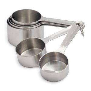 Front view of a set of metal measuring cups, part of the list of Best Kitchen Gifts (for the Hostess, Chef or Foodie)