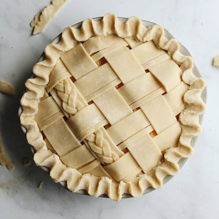 overhead photo of a Butter Pie Crust in a lattice pattern before baking