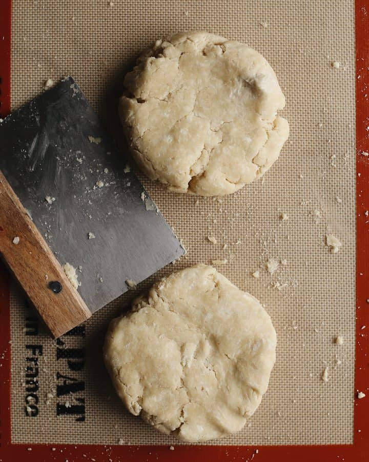 overhead photo showing How to Make Pie Crust - forming dough into two discs