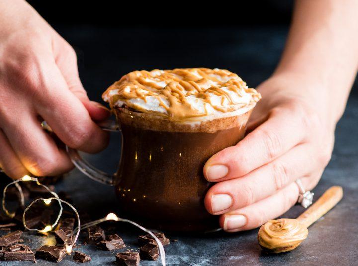 hands holding a mug of Peanut Butter Hot Chocolate