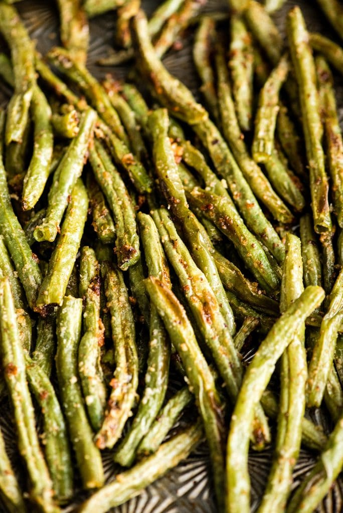 Up close overhead view of Roasted Parmesan Green Beans in the baking pan after they have been roasted