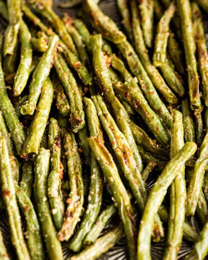 up close overhead view of Roasted Parmesan Green Beans on a baking sheet