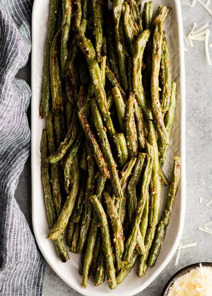 Overhead view of Roasted Parmesan Green Beans on an oval serving dish