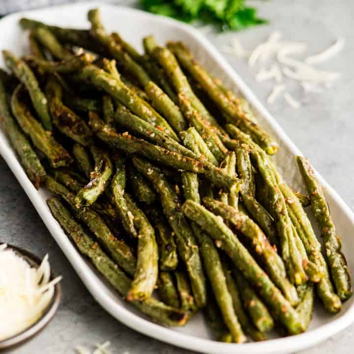 Front view of a serving dish with Roasted Parmesan Green Beans