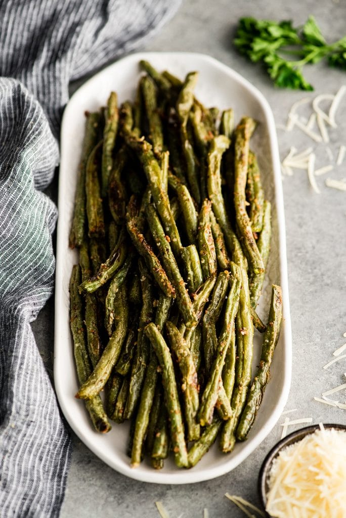 overhead/front view of a serving dish with Parmesan Roasted Green Beans on it