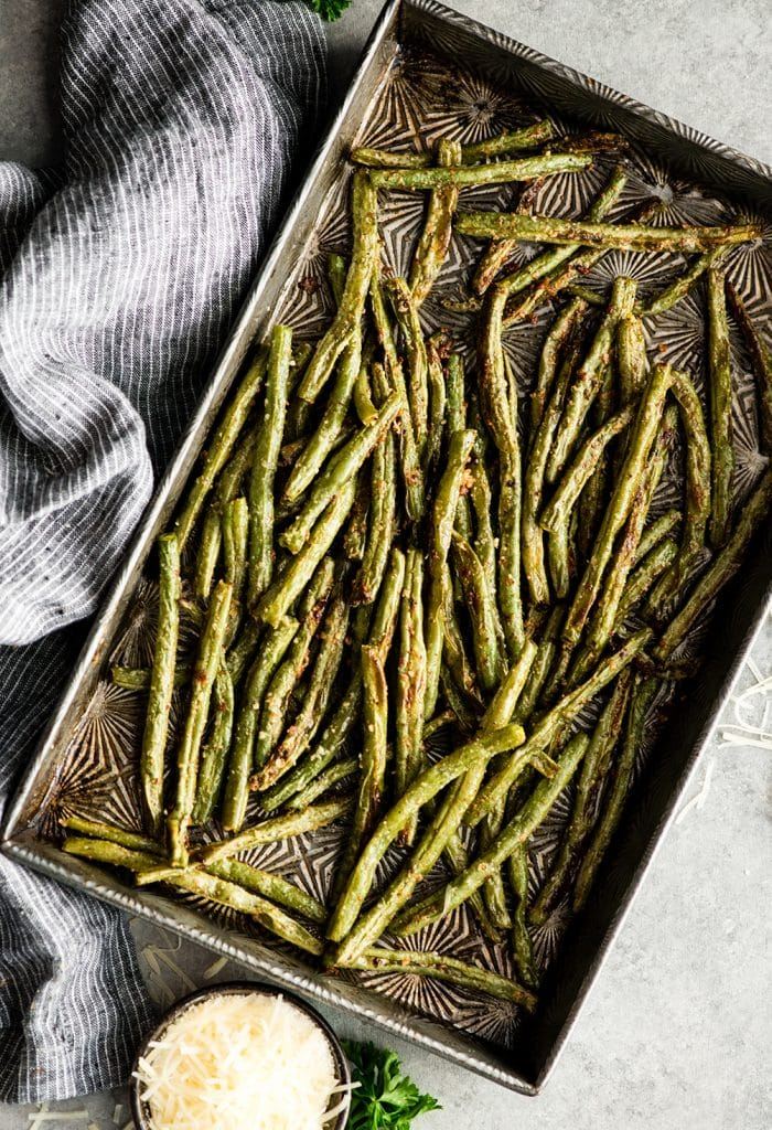 overhead view of Parmesan Roasted Green Beans on a baking sheet after roasting