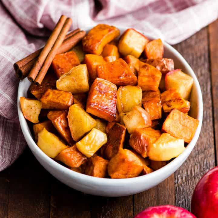 front view of a bowl of Cinnamon Roasted Sweet Potatoes and Apples
