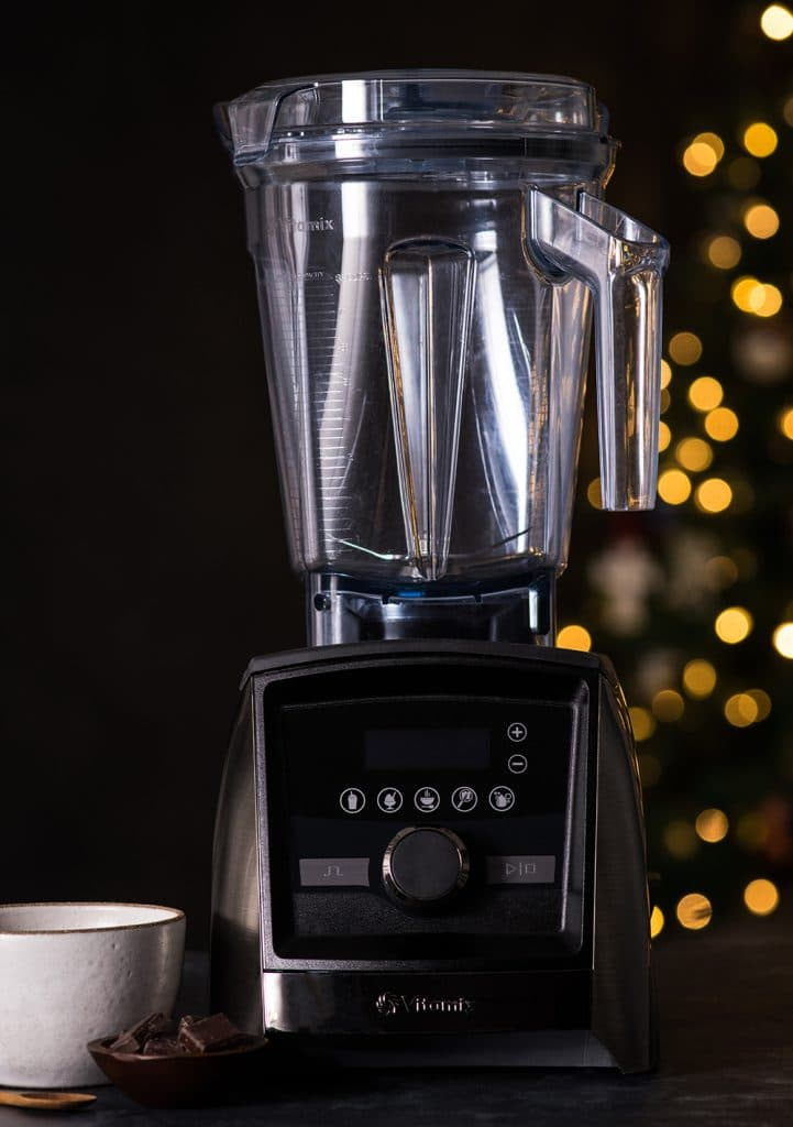 Front view of a Vitamix Ascent 3500 Blender with a Christmas tree in the background, Moments November 2018