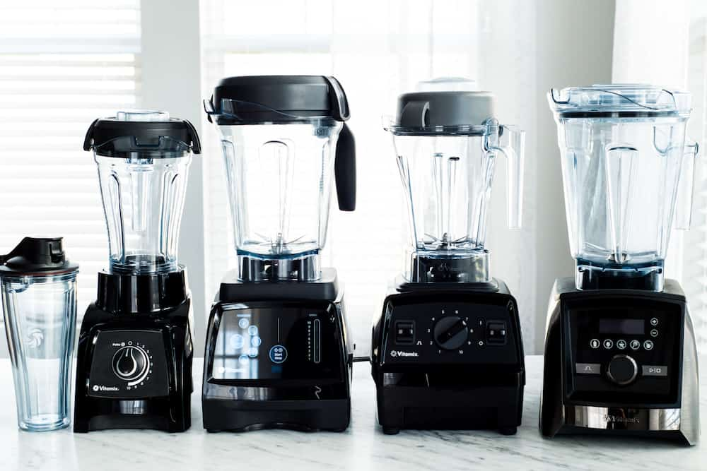front view of four Vitamix Blenders in this post answering the question Which Vitamix is the Best? (Vitamix Comparison & Buying Guide)