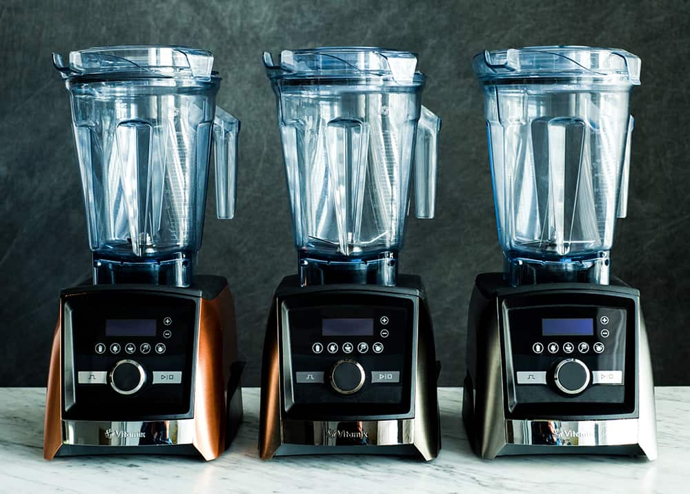 Front view of three Vitamix A3500 blenders in 3 colors (stainless, brushed stainless, and copper) in this post answering the question Which Vitamix is the Best? (Vitamix Comparison & Buying Guide)