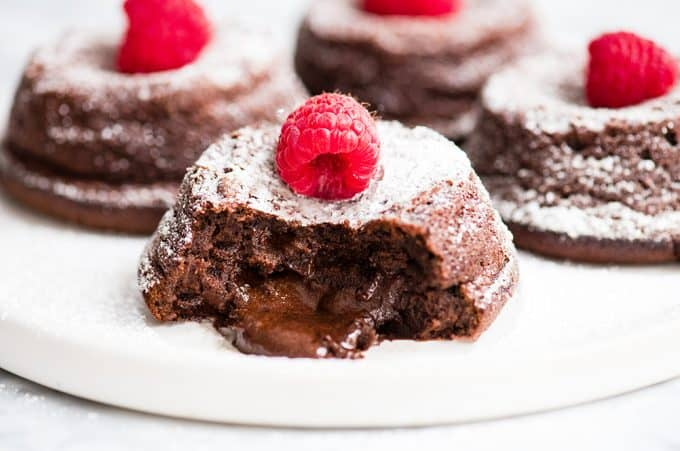 front view of a Molten Chocolate Lava Cake oozing gooey chocolate filling