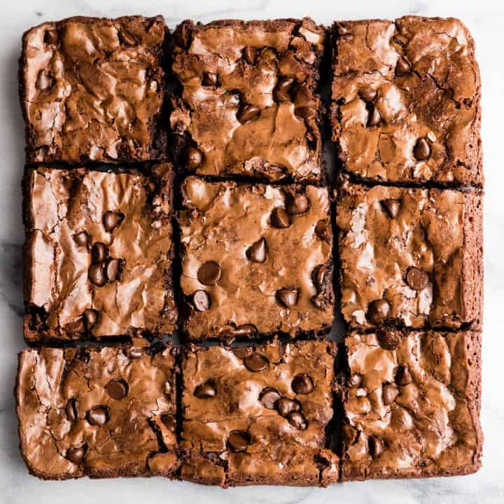Overhead view of nine Paleo Flourless Brownies cut into squares arranged in 3 rows of 3