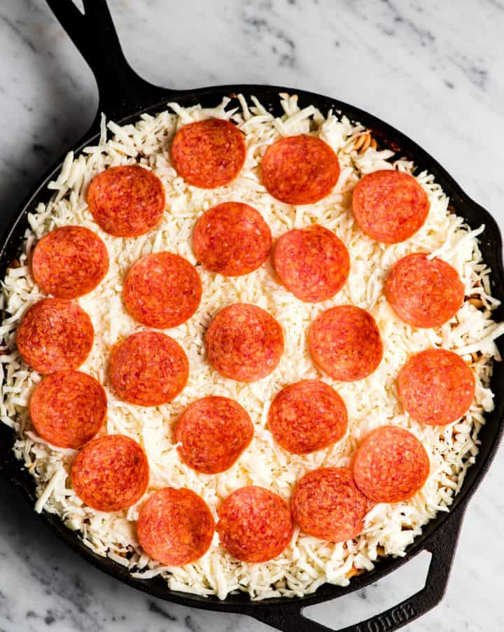 Overhead view of pizza casserole before being baked in the oven.