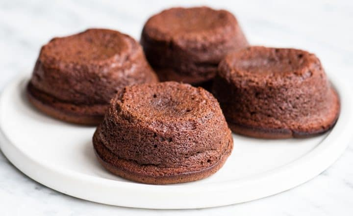 Front view showing four Molten Chocolate Lava Cakes on a plate after baking