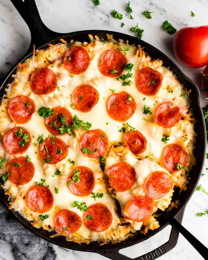 overhead view of Pizza casserole being served garnished with parsley