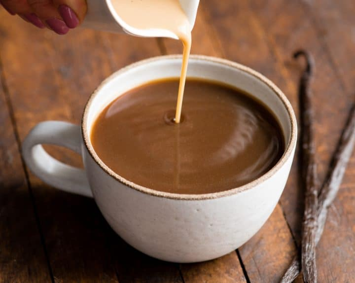 healthy coffee creamer being poured into a cup of coffee