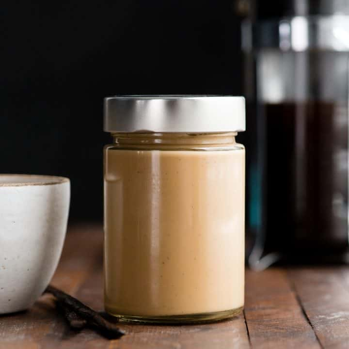 Front view of a glass jar full of healthy coffee creamer.