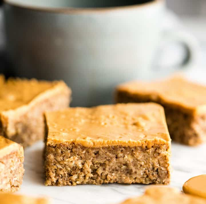 3 Healthy Peanut Butter Breakfast Bars with a cup of coffee in the background