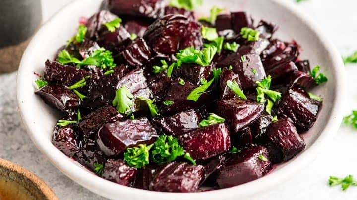 a bowl of Balsamic Roasted Beets garnished with greens