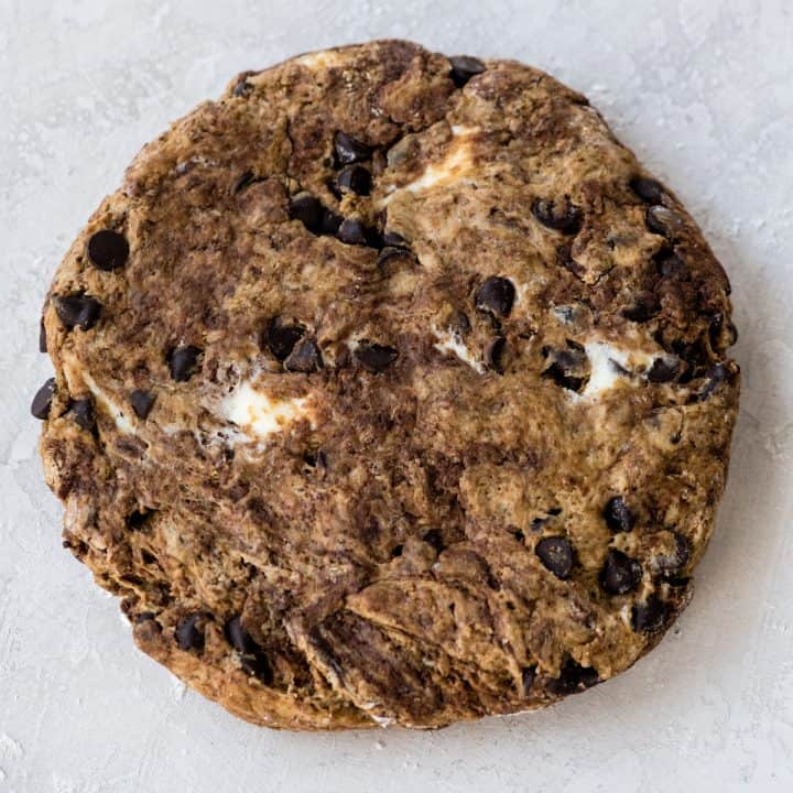 overhead up close view of the chocolate scone dough shaped into a circle