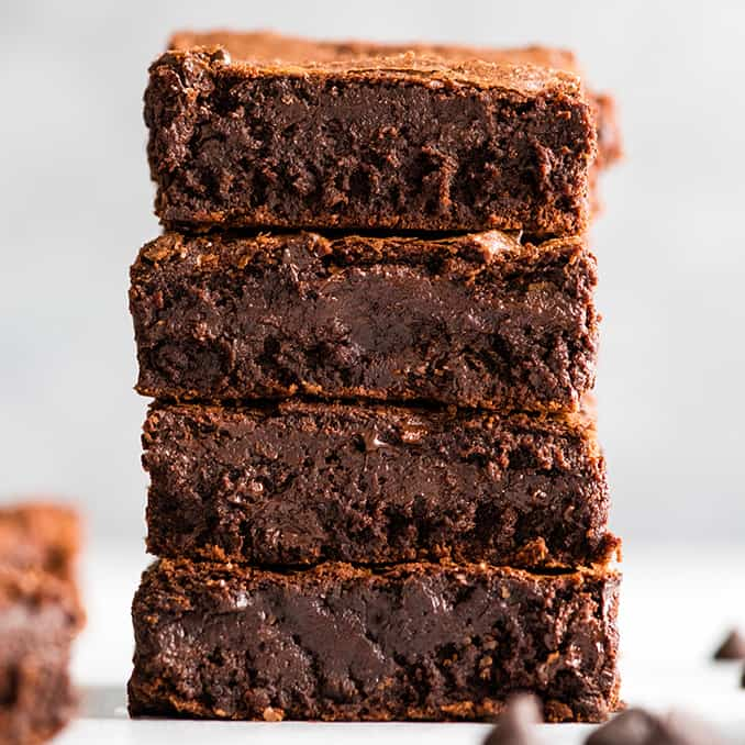 up close front view of a stack of 4 brownies made with the Brownie Recipe