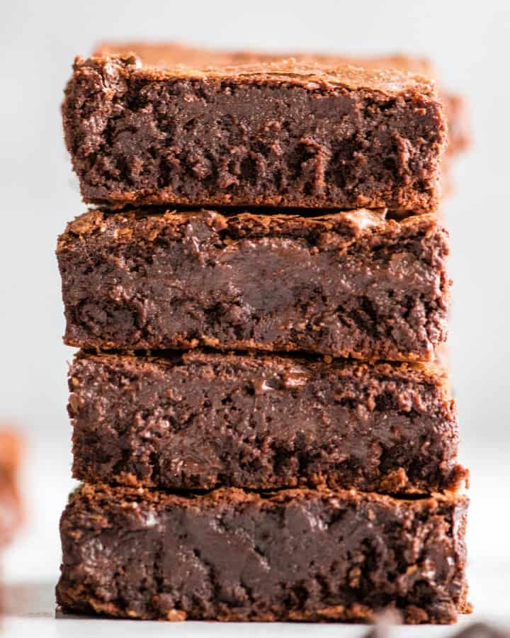 front view of a stack of 4 fudgy brownies