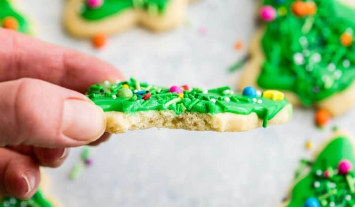 front view of a cut-outsugar cookie with a bite taken out of it