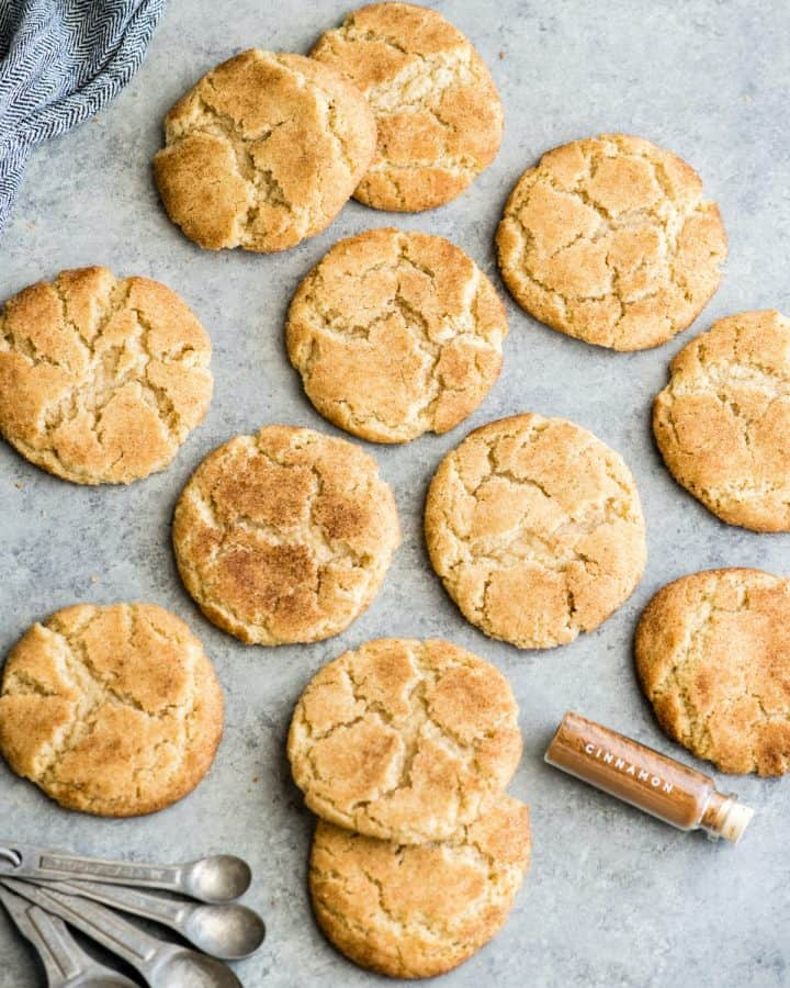 overhead view of 12 Snickerdoodle Cookies on a surface.