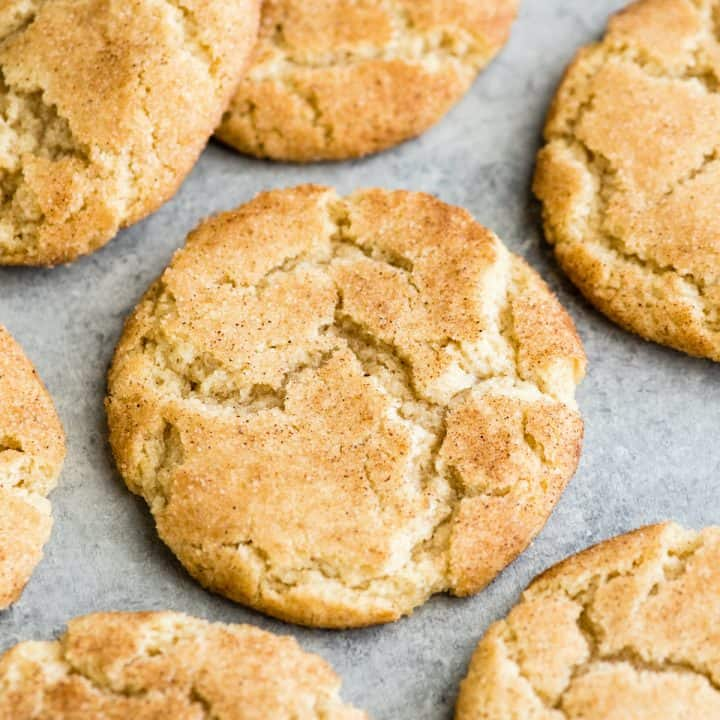 overhead view of 5 Snickerdoodle Cookies on a surface.